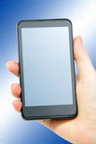 Smartphone on blue Royalty Free Stock Photography