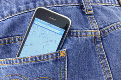 Smartphone in blue jean pocket. Smartphone with GPS navigator in blue jean pocket stock photos