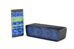 Smartphone and bluetooth speaker Royalty Free Stock Images
