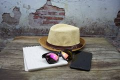 Smartphone and book with the sunglass stock photos