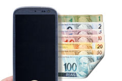 Smartphone and Brazilian bills - Front Royalty Free Stock Photo
