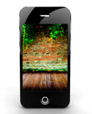 Smartphone with brick wall Royalty Free Stock Image