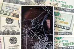 Smartphone with broken display on money background Stock Photography