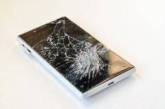 Smartphone with broken display Royalty Free Stock Photo