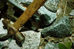 Smartphone broken glass with hammer on gravel stones. Selective focus.  stock images