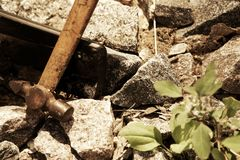 Smartphone broken glass with hammer on gravel stones. Selective focus.  stock photography
