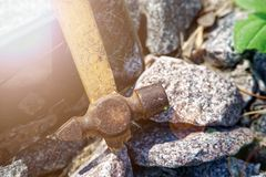 Smartphone broken glass with hammer on gravel stones. Selective focus with sum beam. Smartphone broken glass with hammer on gravel stones. Selective  with sum royalty free stock image