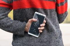 Smartphone with a broken screen. broken phone Close-up stock images