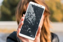 Smartphone with a broken screen. broken phone. Close-up royalty free stock image