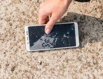 Smartphone with a broken screen. broken phone. Close-up stock photos