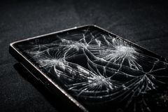 Smartphone with broken screen. On dark background royalty free stock photography