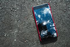 Smartphone with broken screen stock photo