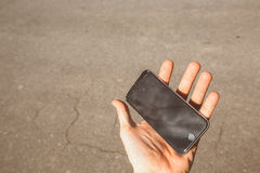 Smartphone with broken screen in hand Royalty Free Stock Photo