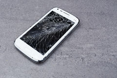 Smartphone with broken screen. New smartphone with broken screen royalty free stock photography