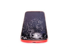 Smartphone with broken screen. Broken screen pink phone isolated on white royalty free stock photography