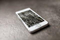 Smartphone with broken screen. On dark background stock photos