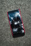 Smartphone with broken screen. On the ground royalty free stock image