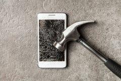 Smartphone with broken screen stock images