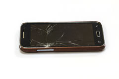 Smartphone with broken screen. On white background stock image