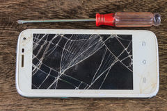 Smartphone with broken screen Stock Photography