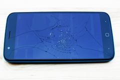 Smartphone with broken screen stock images