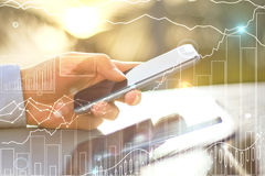 Smartphone with business chart. Closeup of male hand using smartphone with creative business chart. Global/international business concept royalty free stock photos