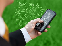 Smartphone with business scheme Royalty Free Stock Photo