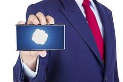 Smartphone on businessman hand Royalty Free Stock Photos