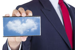 Smartphone on businessman hand Royalty Free Stock Image