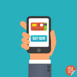 Smartphone with buy now button and credit card icon in hand for website or mobile application. Stock Photo