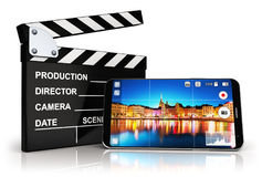 Smartphone with camera app and clapper board. Creadtive abstract digital photography art and internet web wireless video technology business concept: 3D render Royalty Free Stock Photography