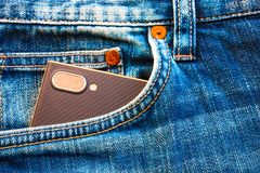 Smartphone with camera in blue jeans pocket royalty free stock images