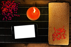 Smartphone, candle and towel Stock Photos