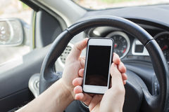 Smartphone in the car royalty free stock photos