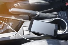 Smartphone in a car use for Navigate or GPS. Driving a car with Smartphone Stock Images