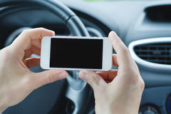 Smartphone in the car Royalty Free Stock Photo