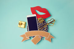 Smartphone with cardboard banner and gift box. Creative website hero image. Stock Photography