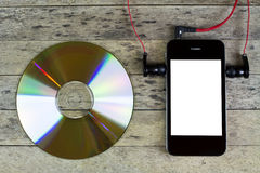 Smartphone, cd disc, headphone Stock Image