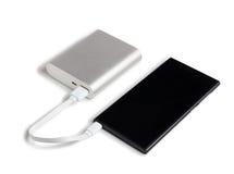 Smartphone charge Photo libre de droits