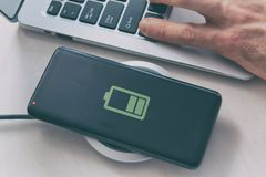 Free Smartphone Charging On A Wireless Charger Royalty Free Stock Photo - 139275625