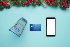 Smartphone with Christmas decorations. Christmas mock up template. View from above Royalty Free Stock Images
