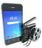 Smartphone and cinema clap and film reel, over white. Background Stock Image