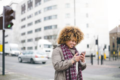 Smartphone in the City Stock Photography