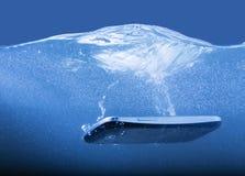 Smartphone closeup thrown into water Royalty Free Stock Photos