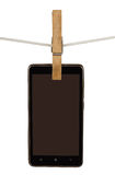 Smartphone on clothesline Stock Images