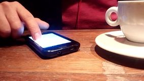 Smartphone at coffee stock video footage