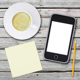 Smartphone and coffee cup Stock Photo