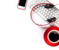 Smartphone, coffee, keyboard and headphones Royalty Free Stock Photos