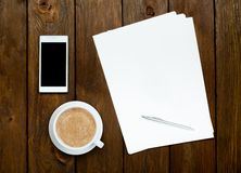 Smartphone, coffee and paper sheets Royalty Free Stock Photography