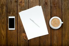 Smartphone, coffee and paper sheets Royalty Free Stock Image